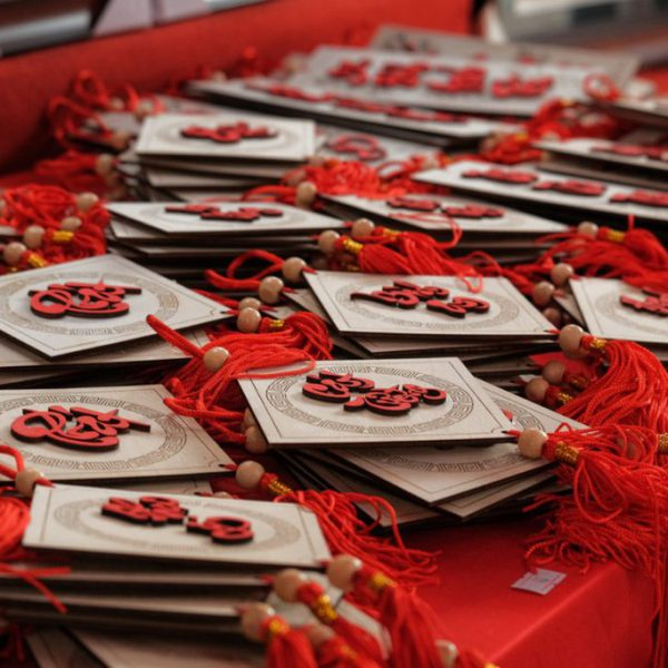 white-and-red-lucky-charm-on-red-table-3626475