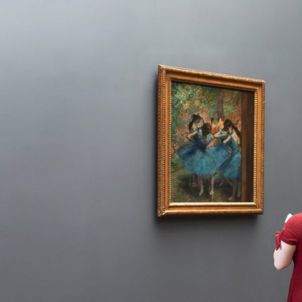 a-woman-in-an-art-gallery-ponders-a-degas-painting